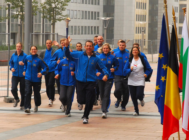 Runners running into the ceremony at the European Parliament