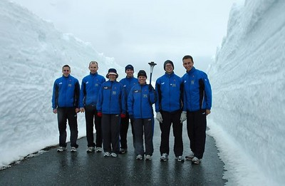 Team by snow walls