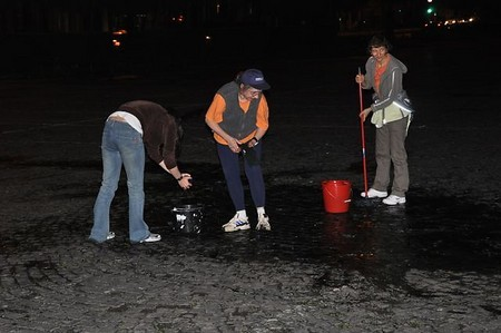 volunteers come out to dry up rain water