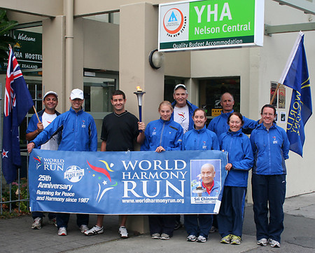 The New Zealand World Harmony Run team outside the YHA in Nelson with the YHA manager Sean Gidall